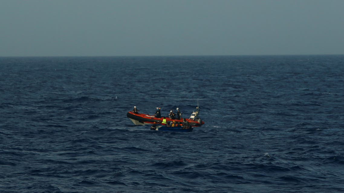 A rigid-hulled inflatable boat (RHIB) from German NGO migrant rescue ship Sea-Watch 3 approaches a wooden boat carrying 12 migrants in international waters, north of Libya, western Mediterranean Sea, August 2, 2021. (Reuters)