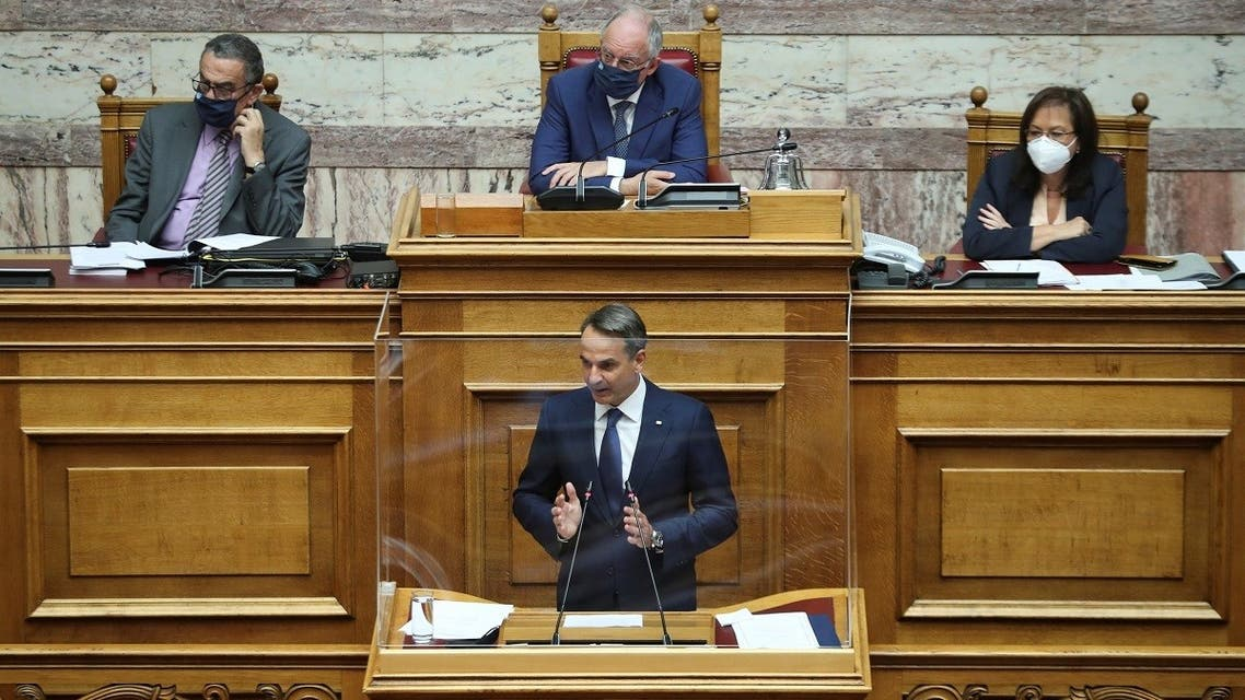 Greek Prime Minister Kyriakos Mitsotakis addresses lawmakers during a parliamentary session before a vote on a defence deal with France, in Athens, Greece, October 7, 2021. (Reuters/Costas Baltas)
