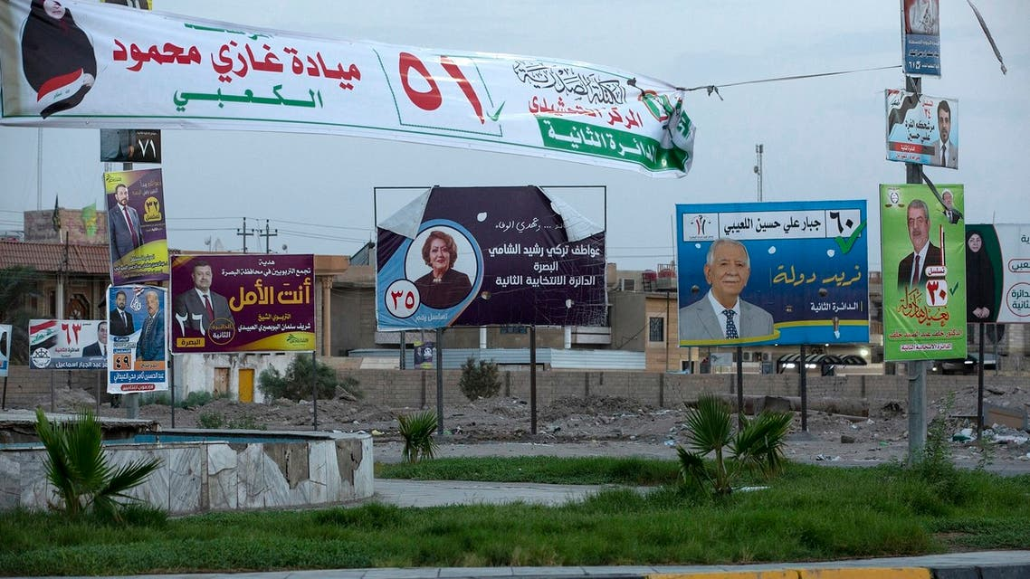 A picture shows electoral campaign posters on October 6, 2021 in the southern city of Basra. War-scarred Iraq will hold parliamentary elections on October 10, a year ahead of schedule to appease an anti-government protest movement, and amid a painful economic crisis.