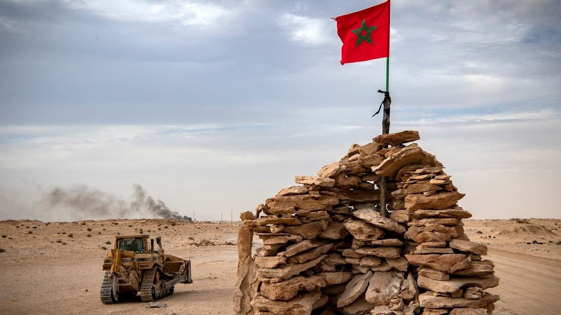 In this file photo taken on November 23, 2020, a bulldozer passes by a hilltop manned by Moroccan soldiers on a road between Morocco and Mauritania in Guerguerat located in the Western Sahara. (Fadel Senna/AFP)