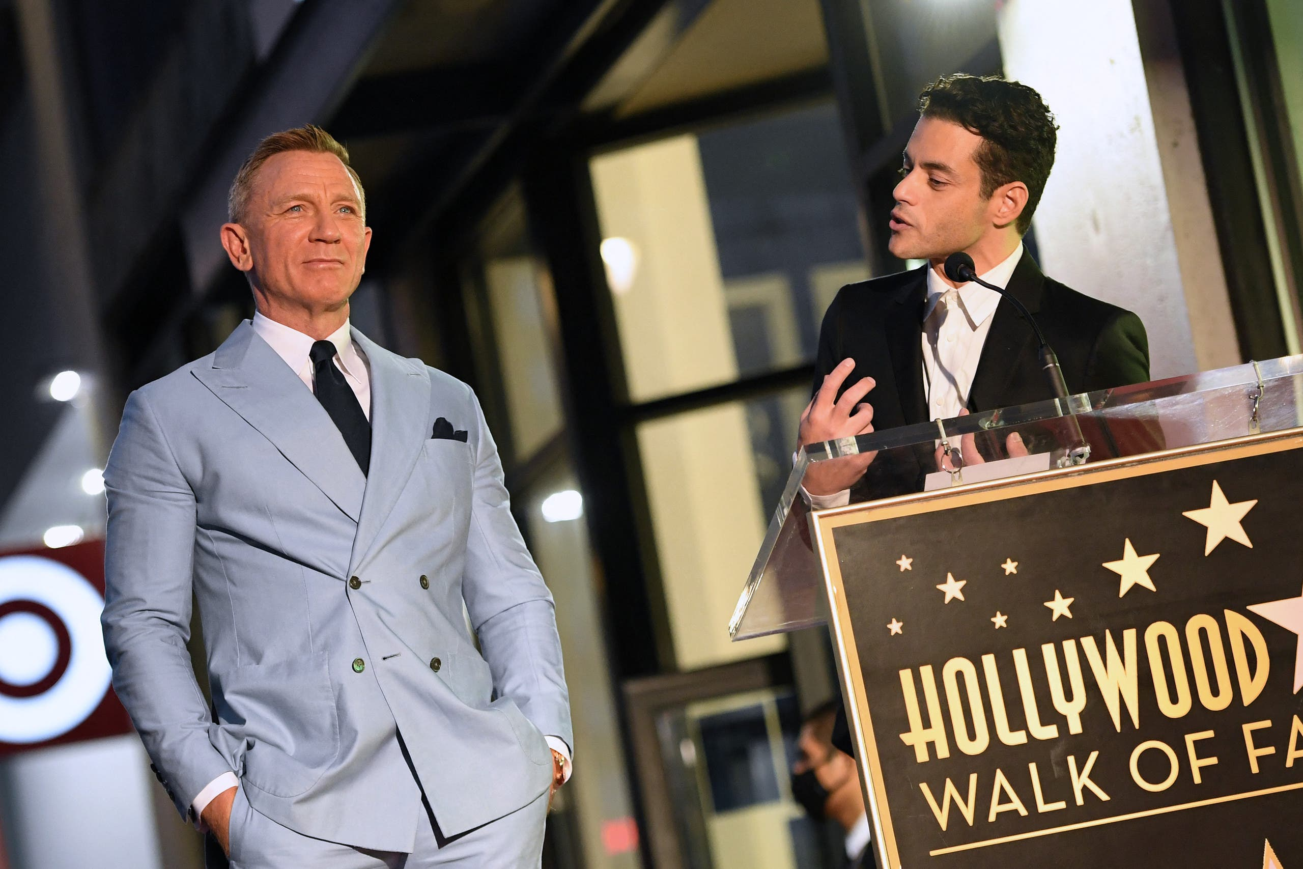 US actor Rami Malek (R) speaks during the ceremony to honor British actor Daniel Craig with a star on the Hollywood Walk of Fame in Los Angeles, California, on October 6, 2021. Craig's star will be located at 7007 Hollywood Boulevard, chosen for Craig's portrayal of James Bond in '007' films. (AFP)