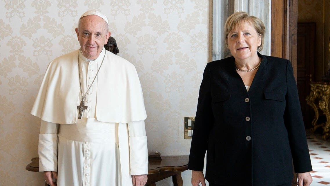 This photo taken and handout on October 7, 2021 by the Vatican media shows Pope Francis and German chancellor Angela Merkel during a private audience at the Vatican. (AFP/Vatican media)