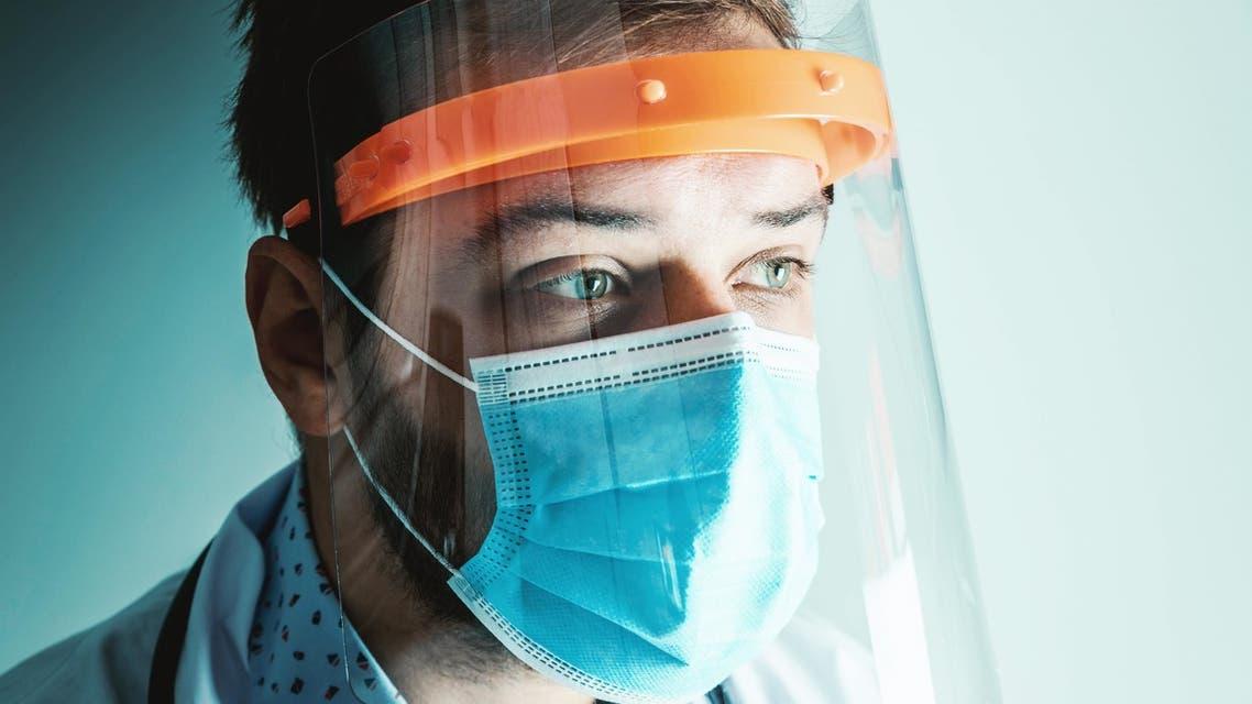 Male Doctor wearing face shield for Coronavirus outbreak or Covid-19. Concept of COVID-19 quarantine. (Unsplash, Jeshoots)