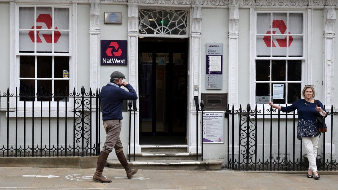 Customers use a NatWest bank on the High Street in Winchester, south west England on March 31, 2021. (File photo: AFP)