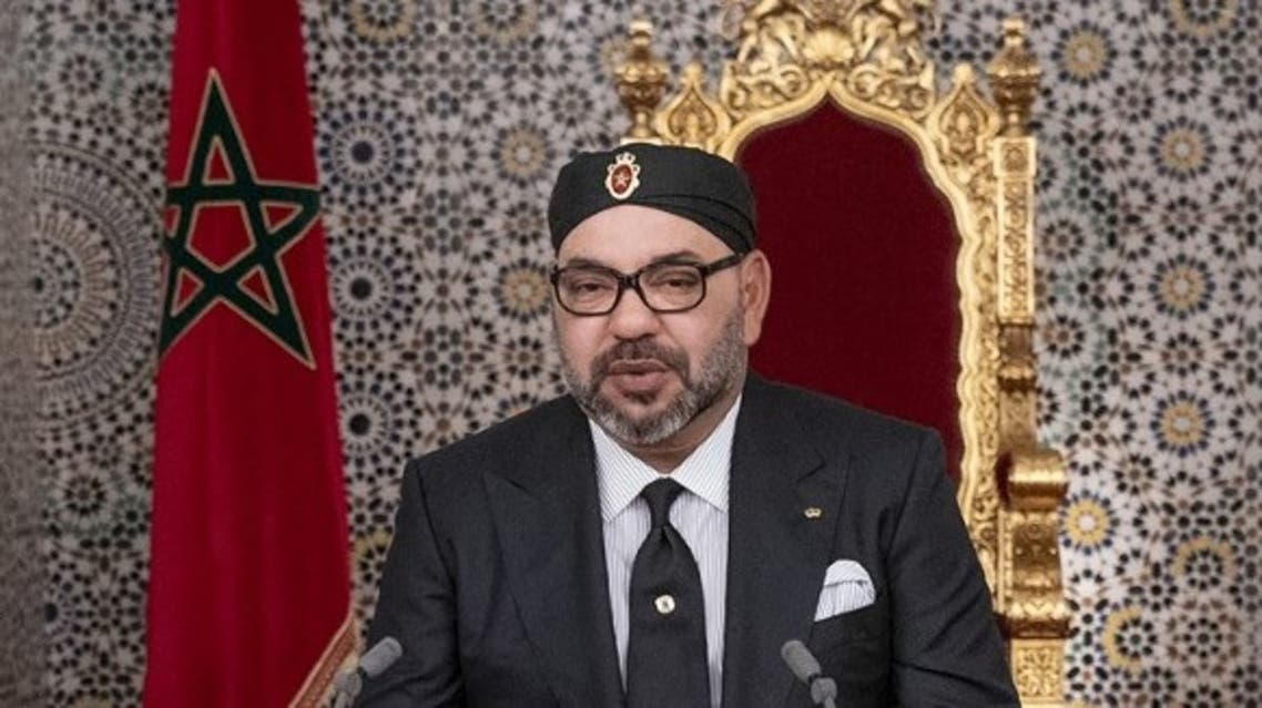 This handout picture provided by the Moroccan Royal Palace on July 29, 2019 shows Morocco's King Mohammed VI (C) delivering a speech marking the 20th anniversary of his accession to the throne. (AFP)