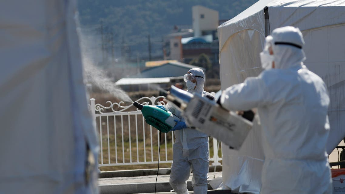 Quarantine workers in protective gear spray disinfectants at a screening facility for checking coronavirus disease (COVID-19) in Cheongdo county, which has been designated as a 'special care zone' since the coronavirus outbreak, near Daegu in North Gyeongsang Province, South Korea, March 11, 2020. (File photo: Reuters)