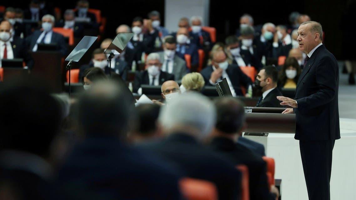 Turkey's President Tayyip Erdogan addresses members of parliament as he attends the reopening of the Turkish parliament after the summer recess in Ankara, Turkey, October 1, 2021. Murat (Cetinmuhurdar/PPO/Handout via Reuters)