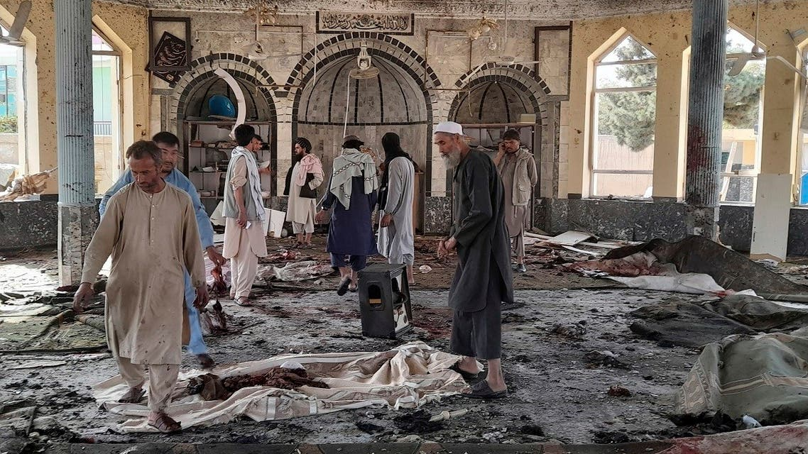 People view the damage inside of a mosque following a bombing in Kunduz, province northern Afghanistan, Friday, Oct. 8, 2021. (AP/Abdullah Sahil)