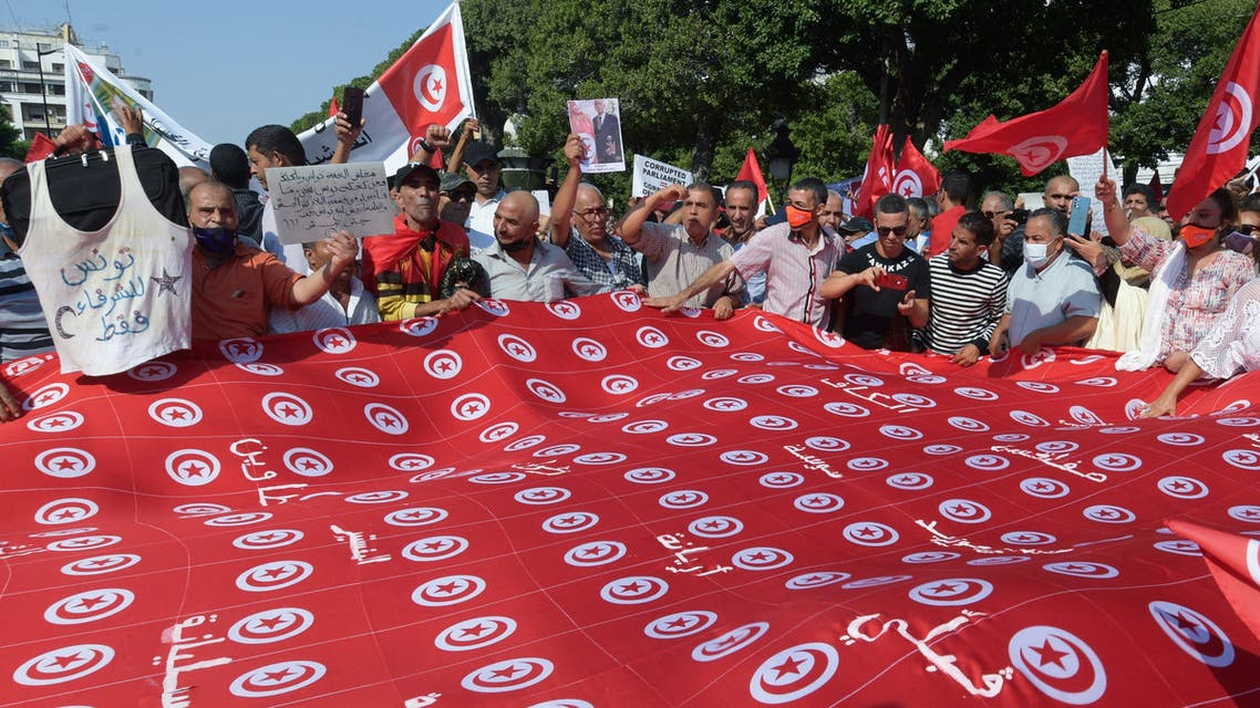 Tunisians chant slogans supporting President Kais Saied during a rally at the Habib Bourguiba avenue in the capital Tunis, on October 3, 2021. Saied on July 25 suspended the legislature, sacked the government and seized control of the judiciary, later moving to rule by decree.