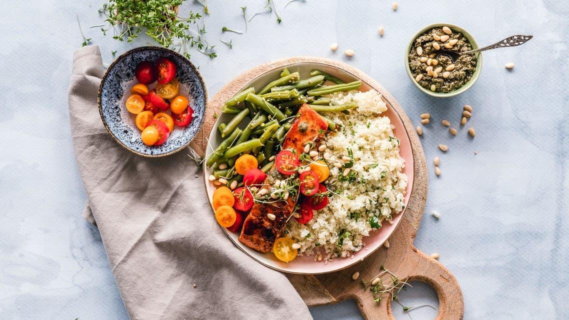Salmon and quinoa dish. (Unsplash, Ella Olsson)