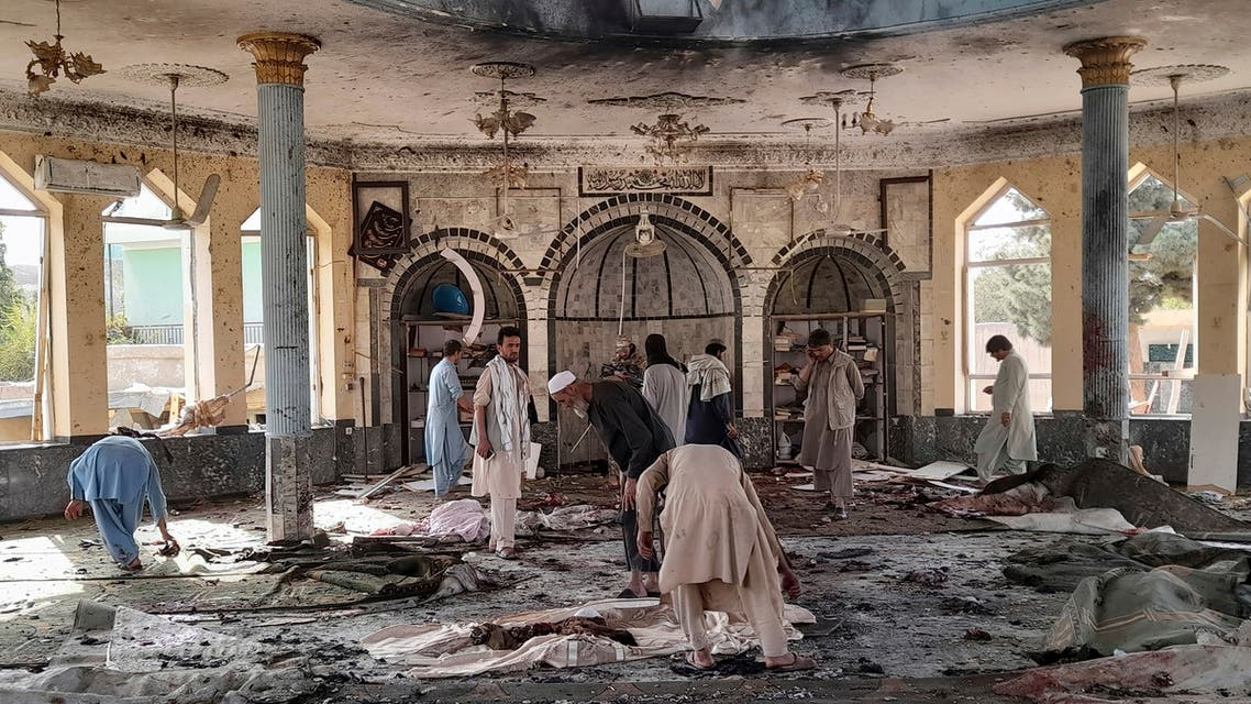 People carry the body of a bombing victim in Kunduz province, northern Afghanistan, Friday, Oct. 8, 2021. A powerful explosion in a mosque frequented by a Muslim religious minority in northern Afghanistan on Friday has left several casualties, witnesses and the Taliban's spokesman said. (AP Photo/Abdullah Sahil)
