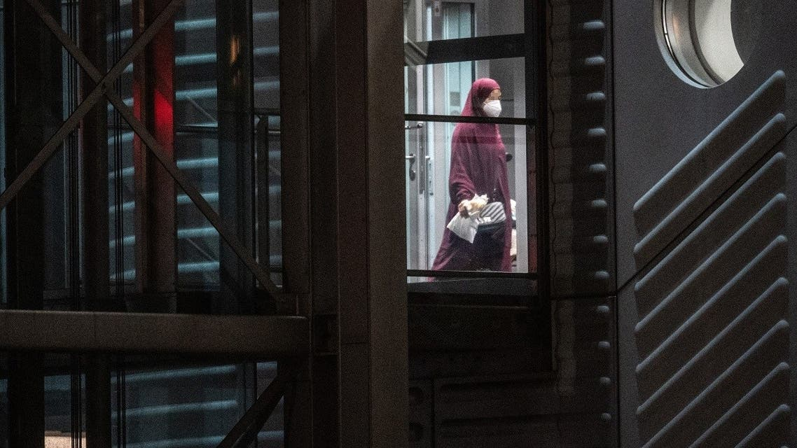 A veiled woman walks through a gangway after leaving a plane that landed at the airport in Frankfurt am Main, western Germany, on October 7, 2021. (Boris Roessler/dpa/AFP)