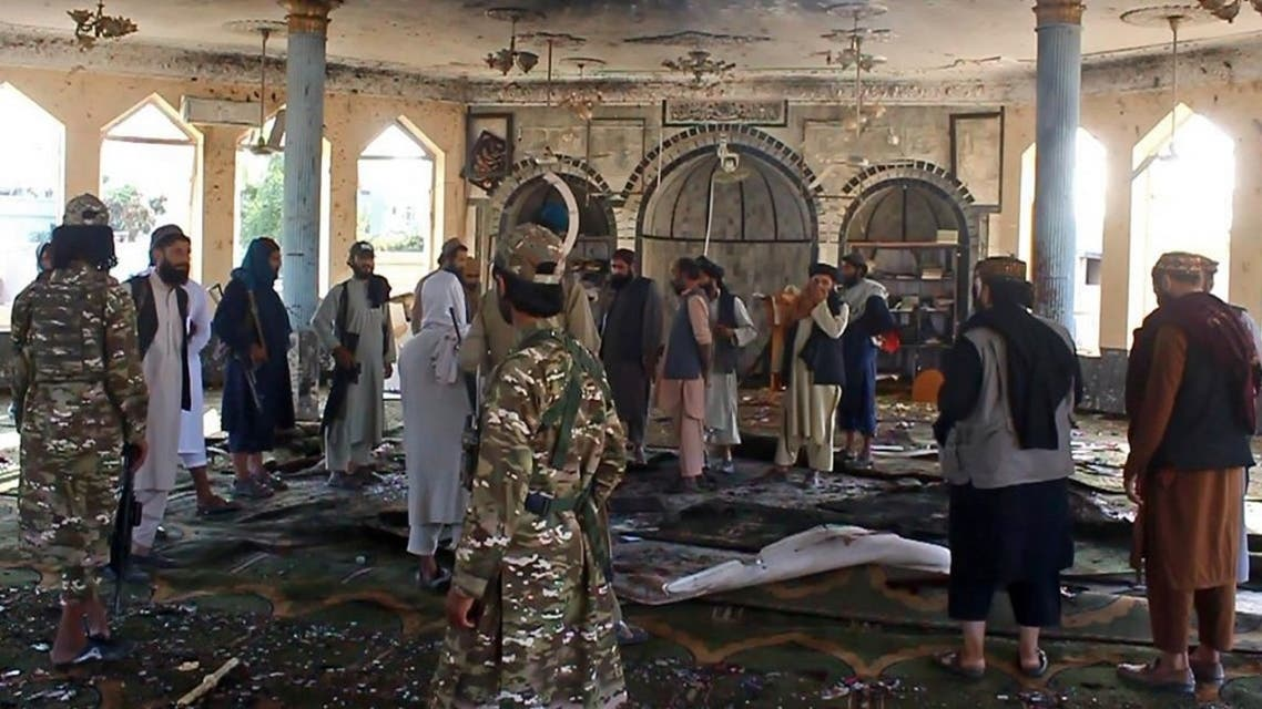 Taliban fighters investigate inside a Shiite mosque after a suicide bomb attack in Kunduz on October 8, 2021. (AFP)