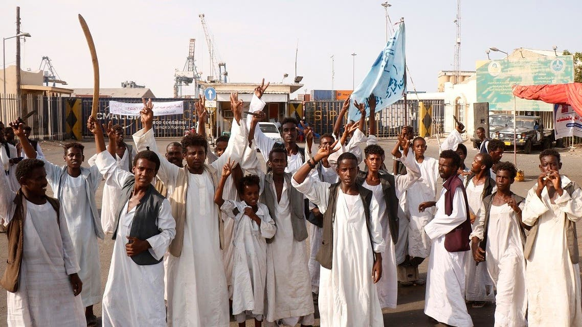 Sudanese protesters gather outside the main entrance to the southern port in Port Sudan on September 20, 2021. (Ibrahim Ishaq/AFP)