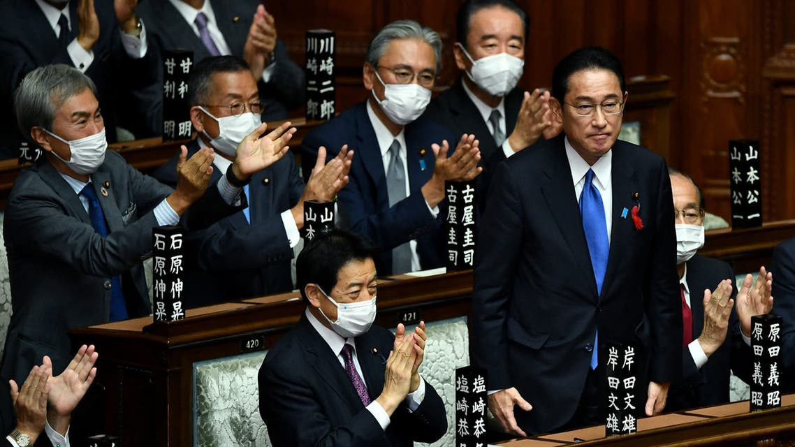 Leader of Japan's ruling Liberal Democratic Party (LDP) Fumio Kishida (2nd R) is applauded after being elected as new prime minister at the lower house of parliament in Tokyo on October 4, 2021. (AFP)