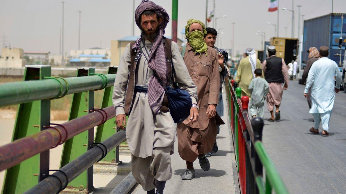 Afghan men walk towards an Afghan-Iran border crossing in Zaranj on September 8, 2021. (AFP)
