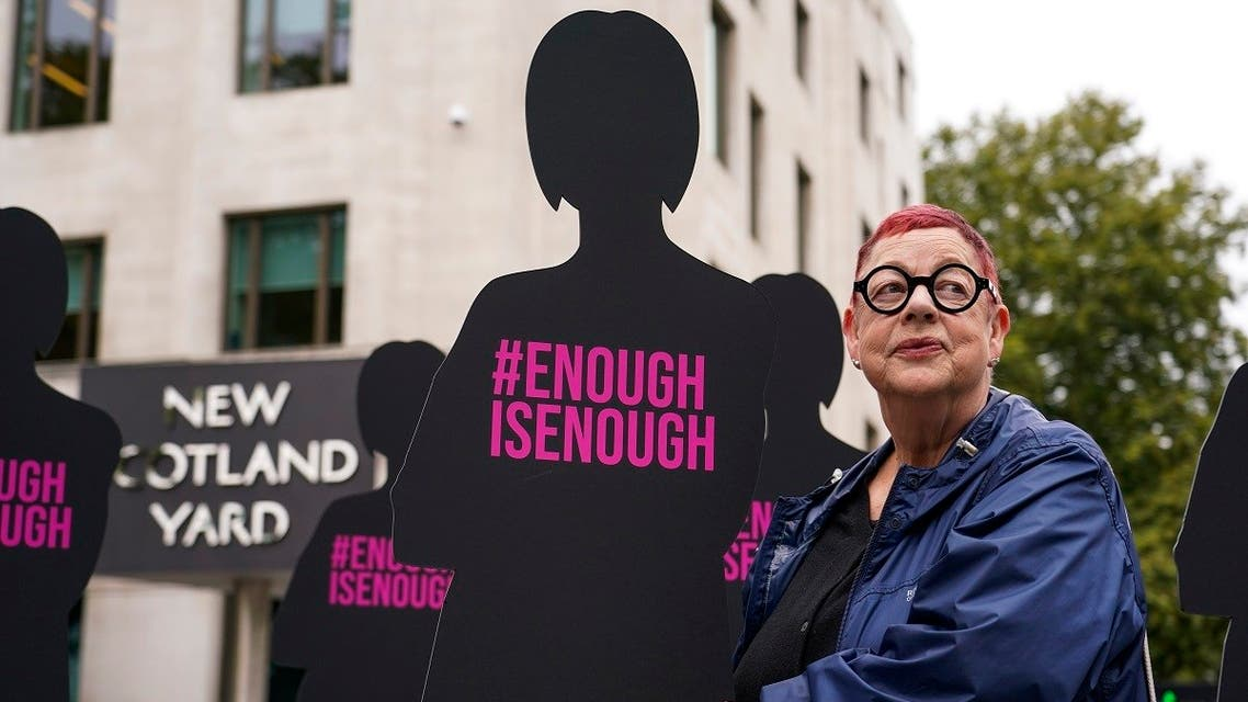British Comedian Jo Brand poses next to silhouettes of women, outside New Scotland Yard, in London, Thursday, Oct. 7, 2021, as part of Refuge's campaign 'Enough is enough' to include domestic abuse, domestic homicide, and sexual violence in the serious violence duty in the Police, Crime, Sentencing and Courts Bill. (AP)