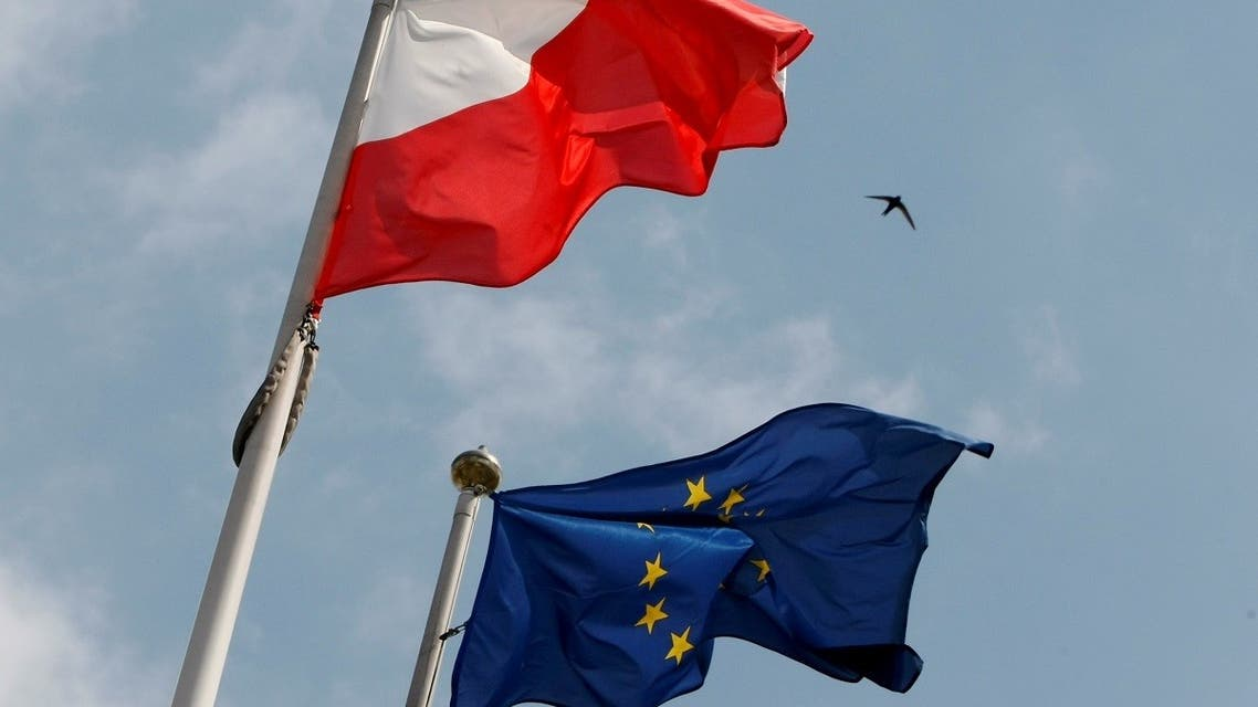 The flags of Poland and European Union flutter in front of the Polish parliament in Warsaw. (Reuters)