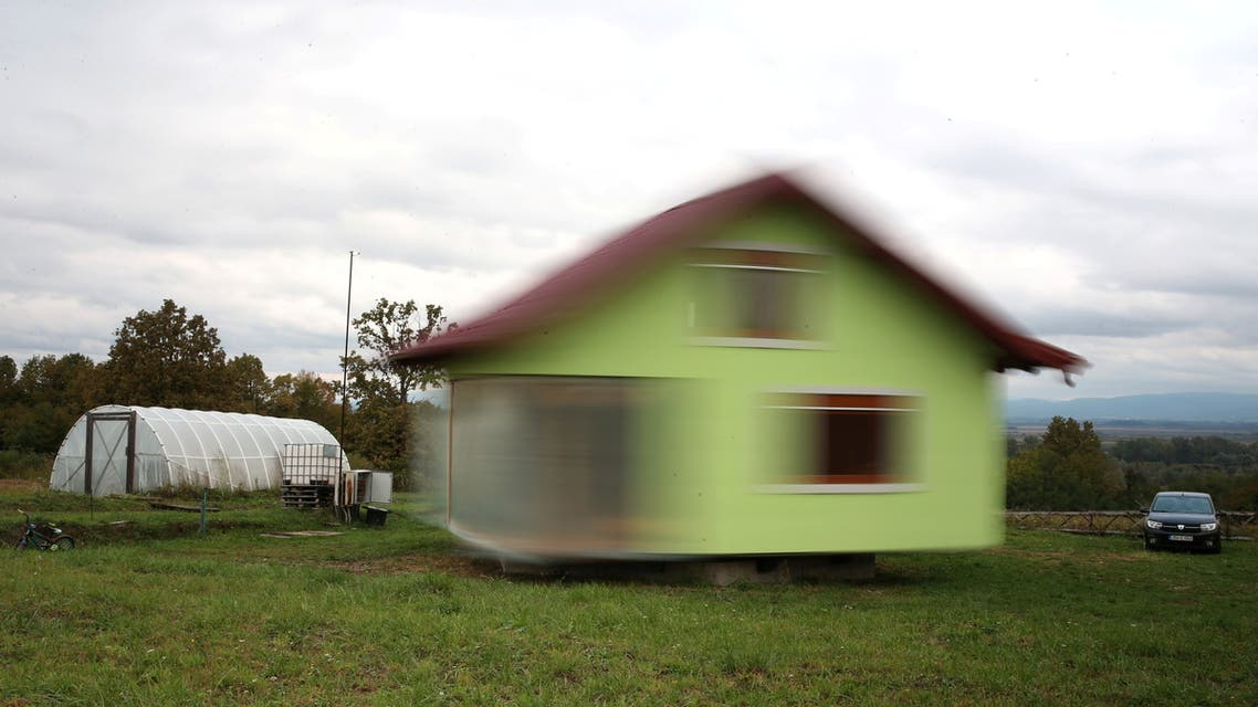 Vojin Kusic house is seen while rotating by electric motors and wheels from a military transporter in Srbac, Bosnia and Herzegovina October 9, 2021. REUTERS/Dado Ruvic