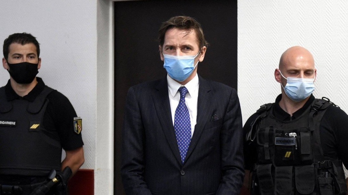 Remy Daillet (C) stands at the beginning of his audition in front of the liberties and detention judge at Nancy courthouse in Nancy, on June 16, 2021. (AFP)