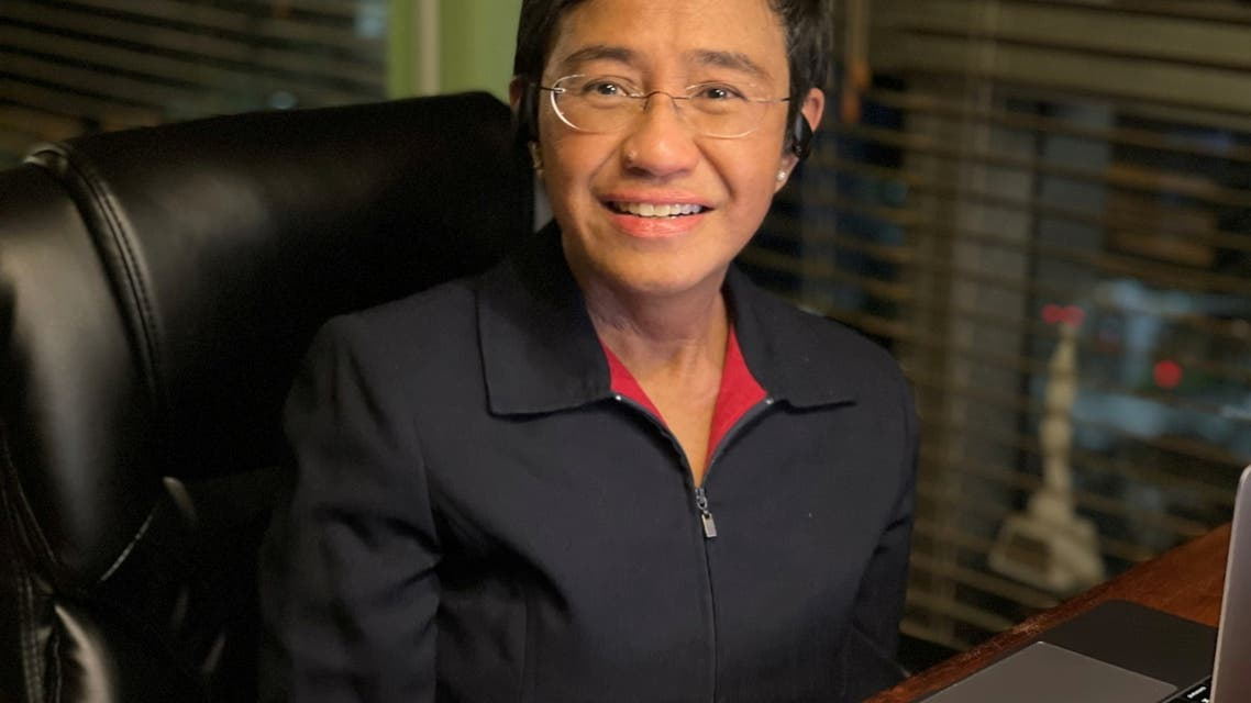 Filipino journalist and 2021 Nobel Peace Prize winner Maria Ressa sits by the desk at her home in Manila, Philippines, October 8, 2021. (Reuters)