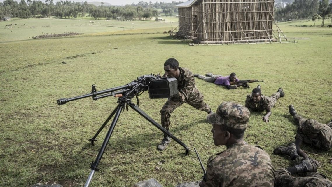 Ethiopian National Defence Forces (ENDF) soldiers train with a DShK 1938, a Soviet heavy machine gun, in the field of Dabat, 70 kilometers Northeast of the city of Gondar, Ethiopia, on September 15, 2021. (AFP)