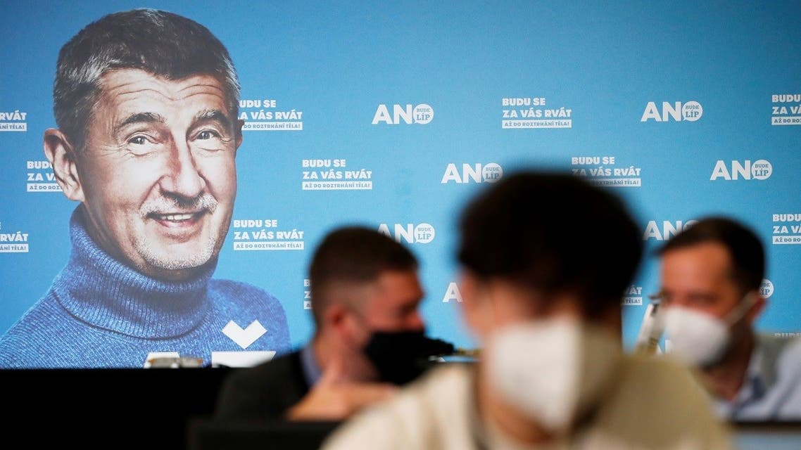 A billboard of Czech Prime Minister and leader of ANO party, Andrej Babis, is seen as journalists wait ahead of a news conference in Prague, Czech Republic October 9, 2021. (Reuters)