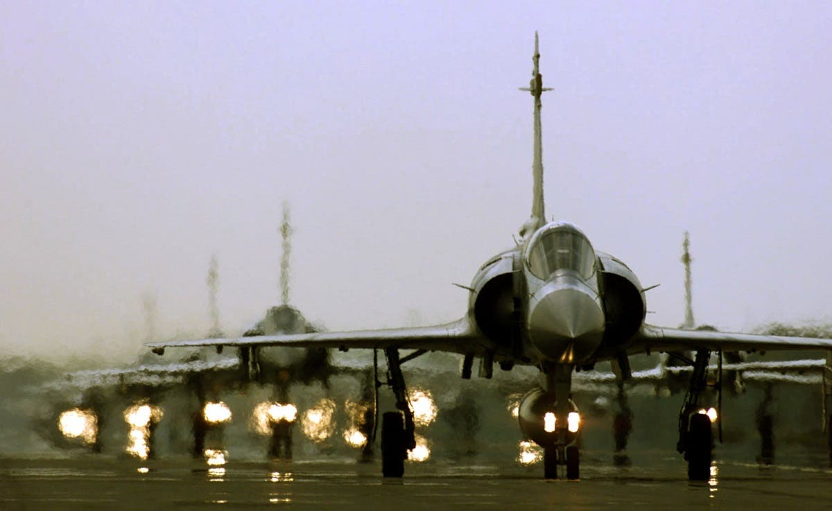 Mirage fighter jets taxi on the runway at a northern Taiwan air force base in Hsinchu. (Reuters)