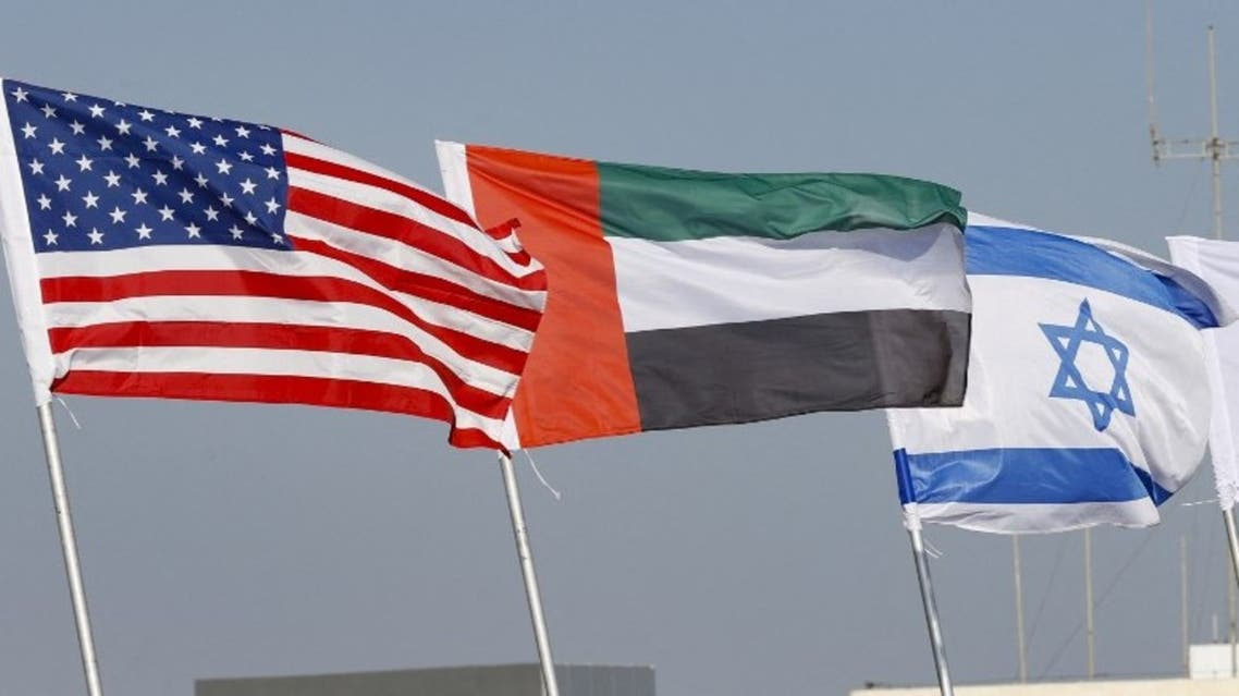 The national flags of (L-R) US, United Arab Emirates, and Israel are flown along a road, in the resort city of Netanya in central Israel, on September 13, 2020. (AFP)
