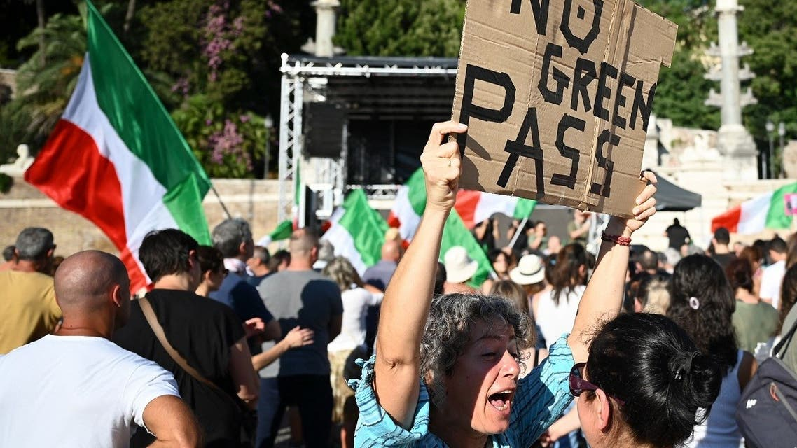 """Members of the 'No Vax' take part in a demonstration against the introduction of a mandatory """"green pass"""" in the aim to limit the spread of the Covid-19, at the Piazza del Popolo in central Rome on August 7, 2021. (AFP)"""