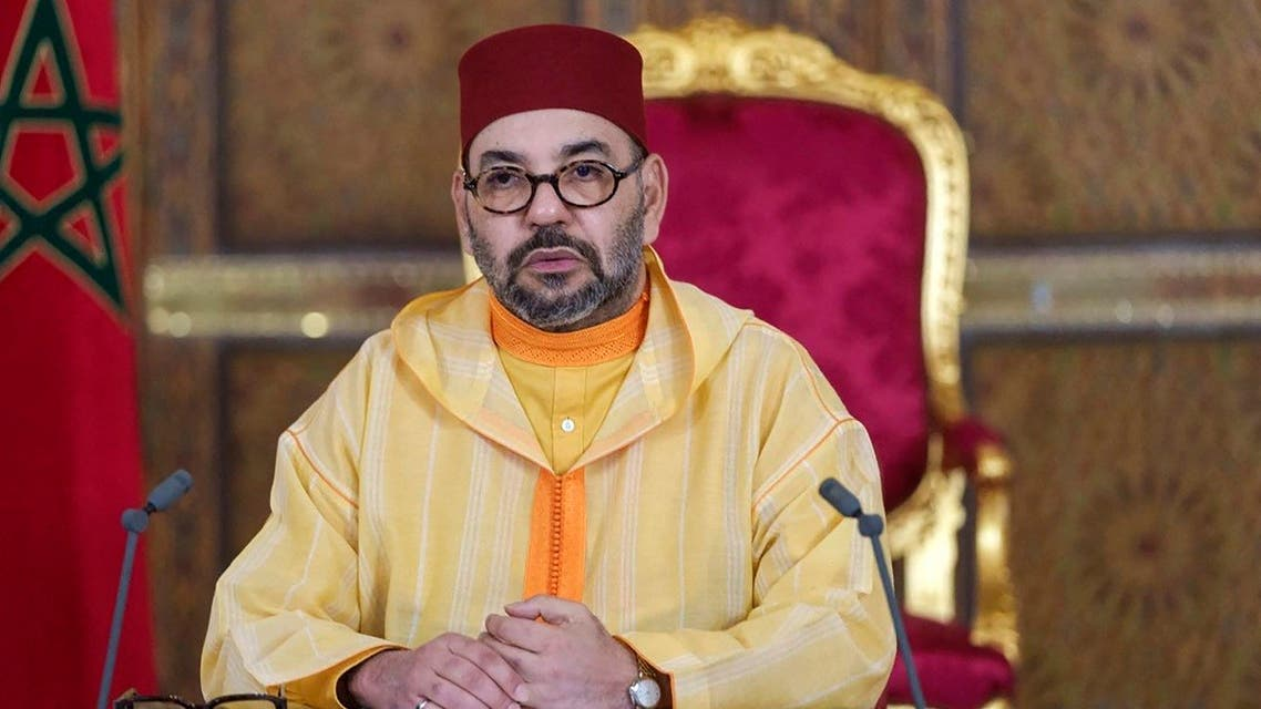A picture released by the Moroccan Royal Palace shows Morocco's King Mohammed VI addressing speech, transmitted via a screen to the parliament, from the Royal Palace in the northeastern city of Fez, on October 8, 2021. (Moroccan Royal Palace/AFP)