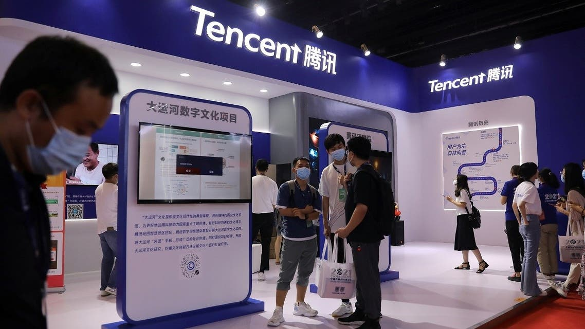 People are seen at a booth of Tencent at an exhibition during China Internet Conference in Beijing, China, on July 13, 2021. (Reuters)