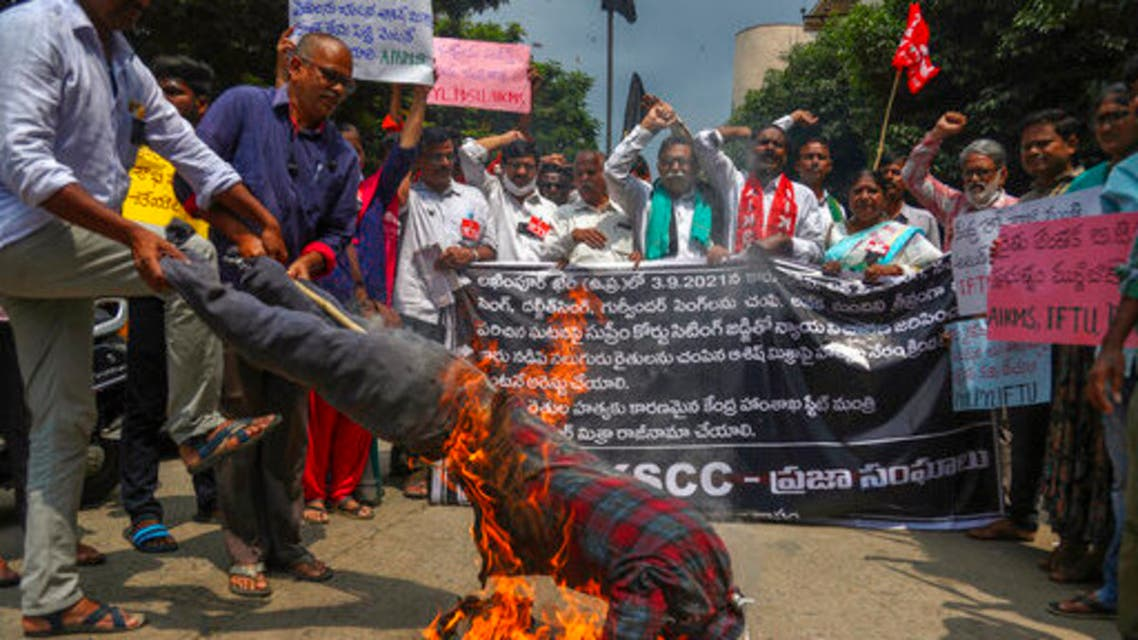 Indian farmers protesting against Sunday's killing of four farmers in Uttar Pradesh state after being run over by a car owned by India's junior Home Minister Ajay Mishra burn an effigy of the federal government in Hyderabad, India, Monday, Oct. 4, 2021. (AP)