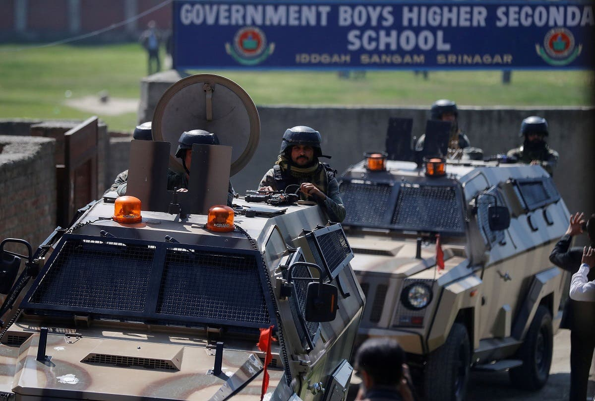Indian security forces keep guard atop armored vehicles, outside a government school after suspected militants shot and killed two teachers in Srinagar, on October 7, 2021. (Reuters)