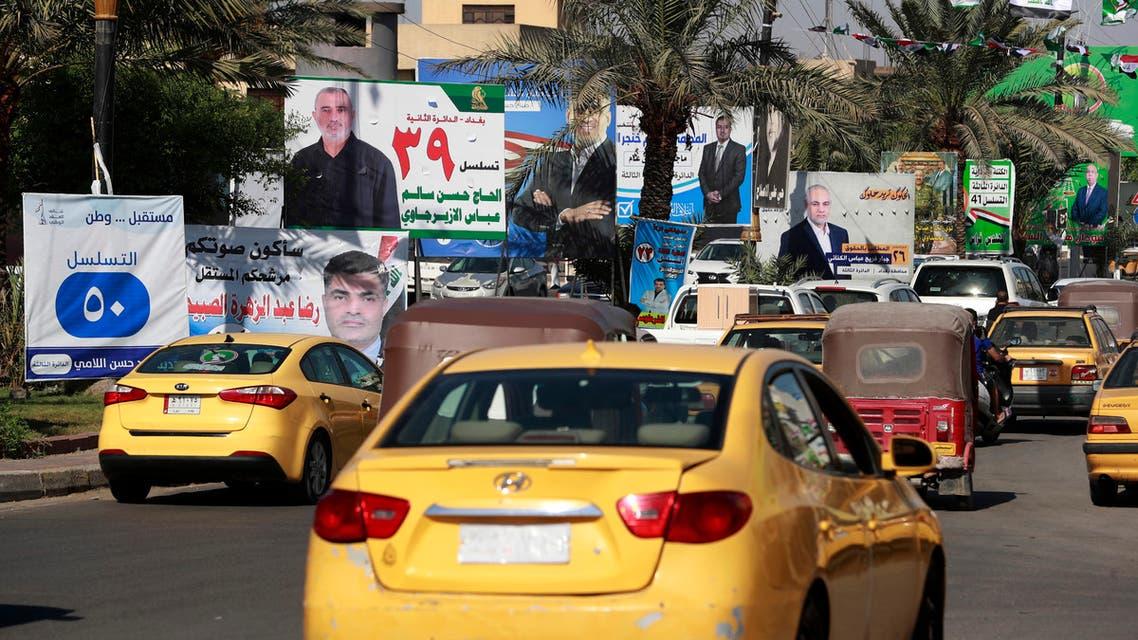 من أحد شوارع بغداد حيث تنتشر صور المرشحين للانتخابات النيابية (أرشيفية- فرانس برس)