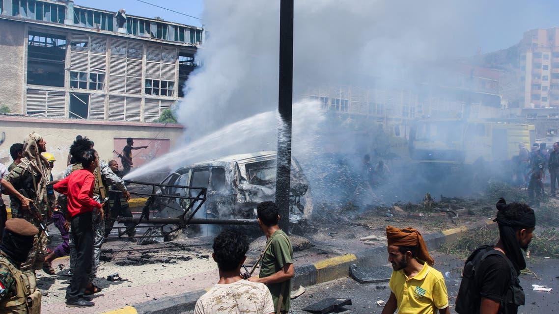 Policemen and firefighters work at the scene of a blast in Aden, Yemen, October 10, 2021. (Reuters)