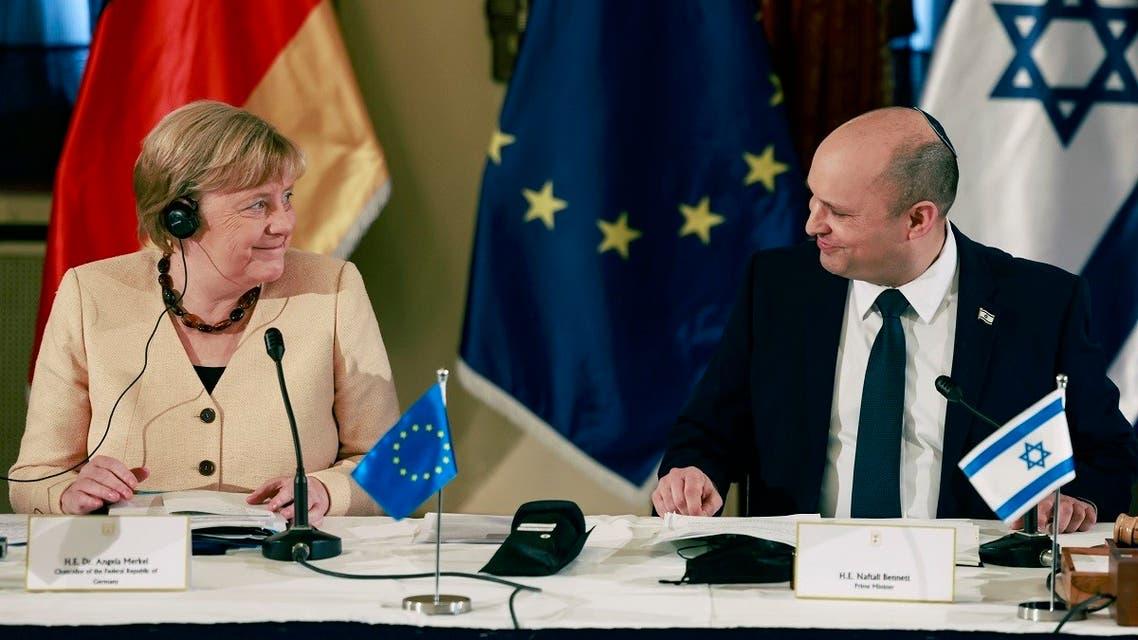 German Chancellor Angela Merkel attends a cabinet meeting with Israeli Prime Minister Naftali Bennett in Jerusalem, on Oct. 10, 2021. (AP)