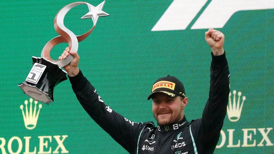 Mercedes' Valtteri Bottas celebrates with the trophy on the podium after winning the Formula One F1 - Turkish Grand Prix race at Intercity Istanbul Park, Istanbul, Turkey, on -October 10, 2021. (Reuters)