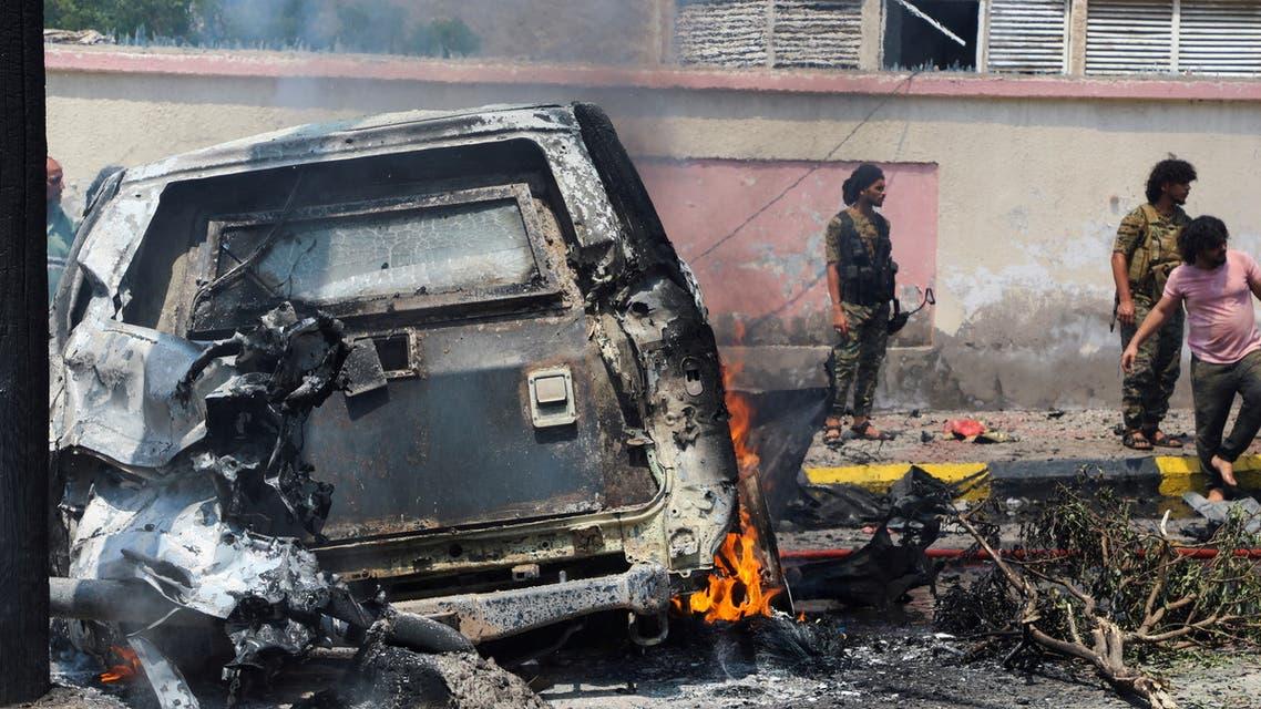 Policemen stand at the scene of a blast in Aden, Yemen, October 10, 2021. (Reuters)