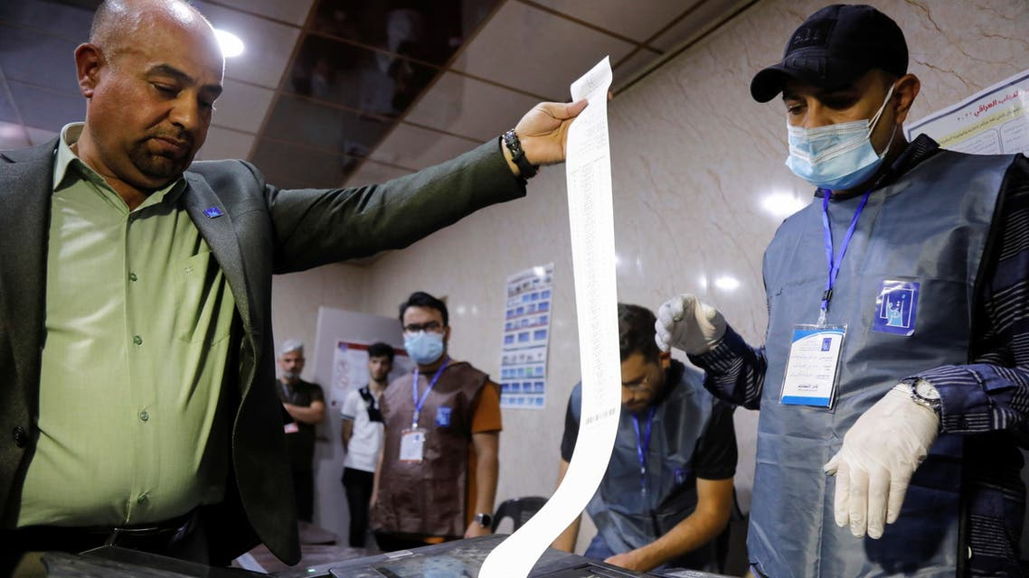 Officials work at a polling station during the parliamentary election, in Mosul, Iraq October 10, 2021. (Reuters)