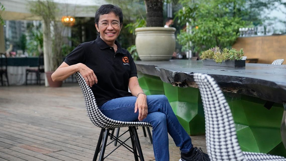 Rappler CEO and Executive Editor Maria Ressa smiles at a restaurant in Taguig city, Philippines on Saturday, Oct. 9, 2021. The Nobel Peace Prize was awarded to journalists Maria Ressa of the Philippines and Dmitry Muratov of Russia for their fight for freedom of expression. (AP)