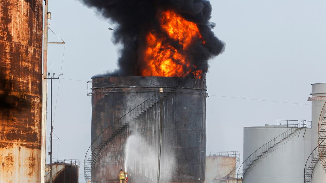 Firefighters attempt to put out a fire at the Zahrani oil facility in southern Lebanon, October 11, 2021 (File photo: Reuters)