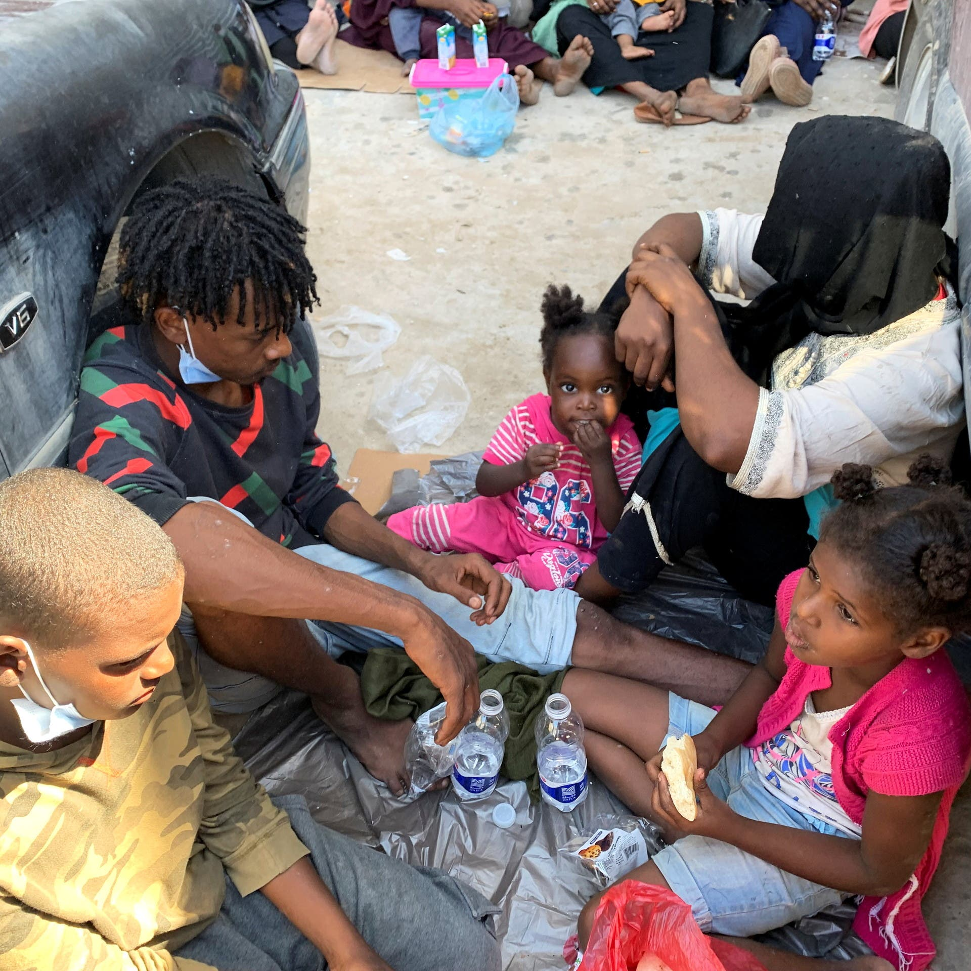 مهاجرون في ليبيا يستغيثون: نعامل كمجرمين