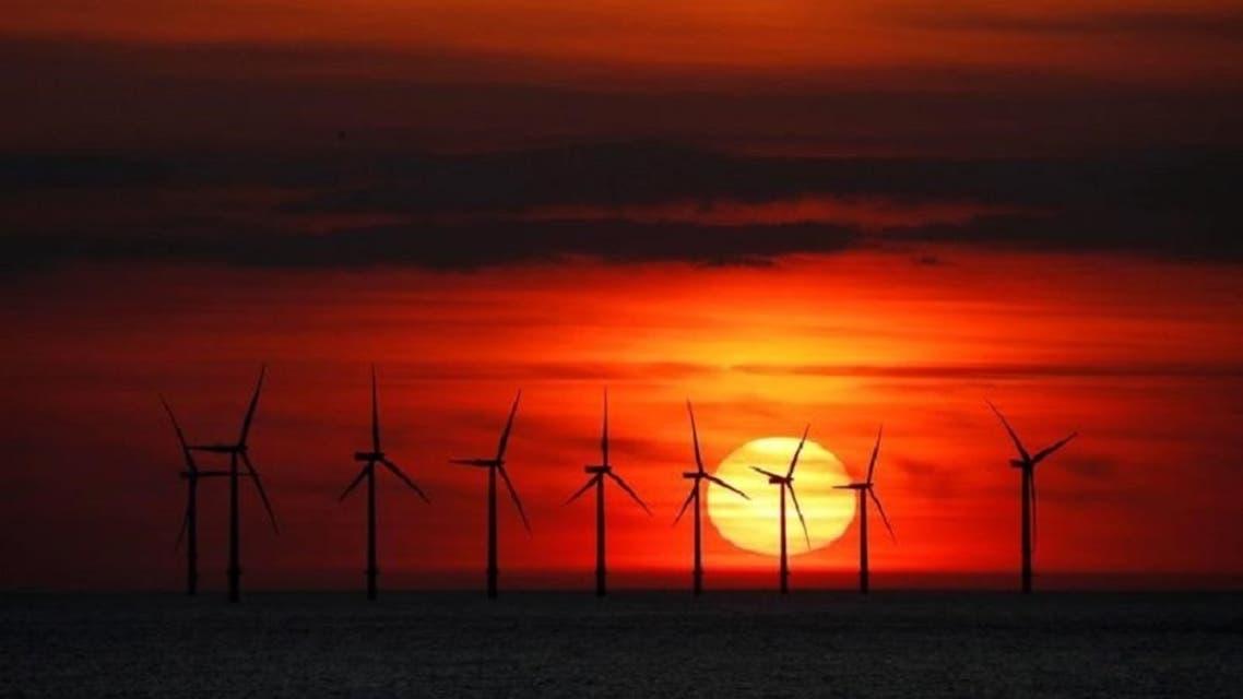 The sun sets behind the Burbo Bank wind farm near New Brighton, Britain. (Reuters)