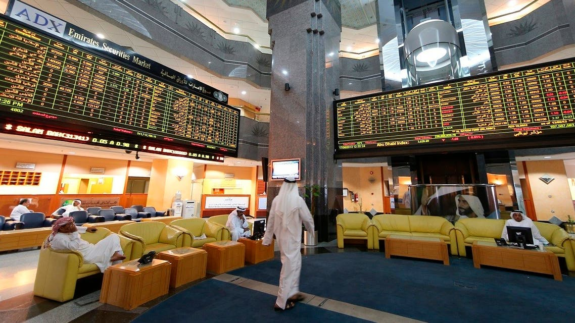 Screens displaying stock information are seen at the Abu Dhabi Securities Exchange. (File photo: Reuters)