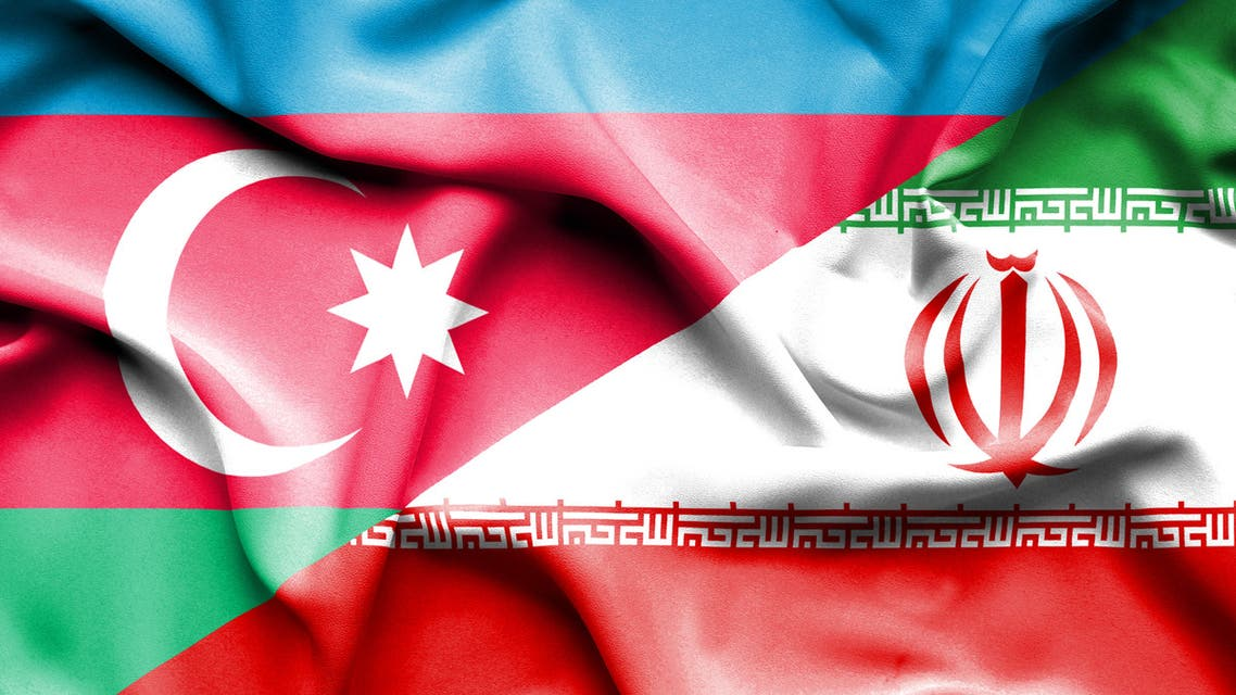 Waving flag of Iran and Azerbaijan stock photo