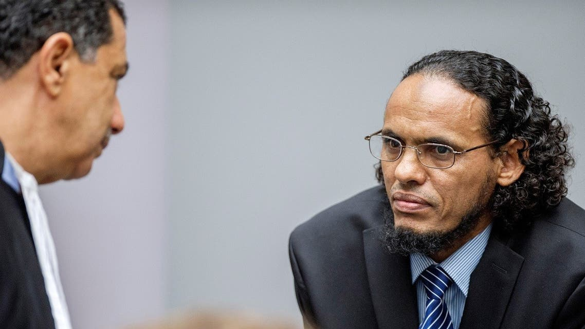 Ahmad al-Faqi al-Mahdi (R) appears at the International Criminal Court in The Hague, Netherlands, August 22, 2016, at the start of his trial on charges of involvement in the destruction of historic mausoleums in Timbuktu during Mali's 2012 conflict. (Reuters)