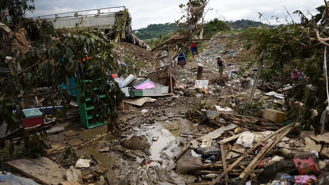 A boy walks on debris from the flood brought by Typhoon Vamco, in Marikina, Metro Manila, Philippines, November 16, 2020. (File photo: Reuters)
