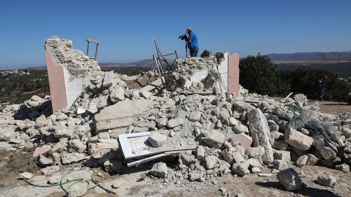 A camera operator films amid the rubble of a demolished church following an earthquake, in the town of Arkalochori on the island of Crete, Greece, September 27, 2021. (File photo: Reuters)