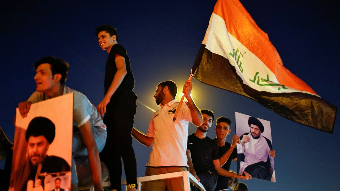 Iraqi supporters of Sadr's movement celebrate after preliminary results of Iraq's parliamentary election were announced in Baghdad, Iraq October 11, 2021. (Reuters)